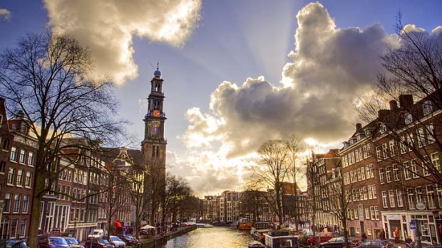 Westerkerk church by a canal in Amsterdam.