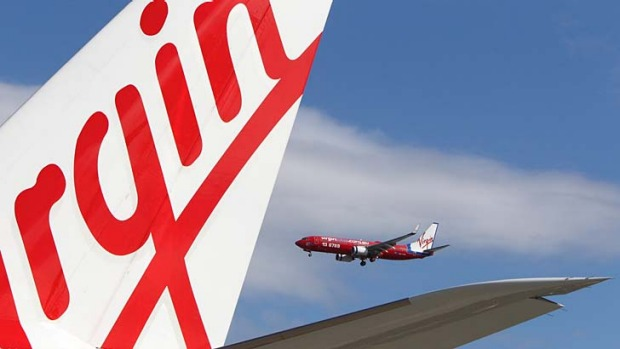 Virgin Australia has dropped the prices of its business-class fares in the escalating domestic airline price war.