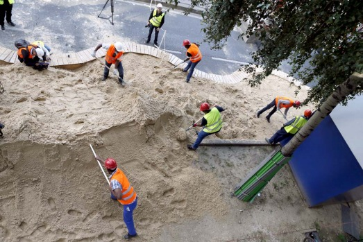 Workers puts down sand along the River Seine in preparation of the 11th edition of Paris-Plage last week.