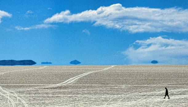 A tourist is seen walking along the salt flats at the Uyuni salt flats, Bolivia.