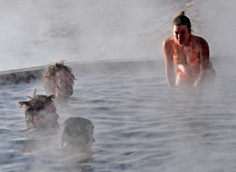 Tourists bathe in hot springs near the small village of Agua Brava, more than 4000 meters above sea level, in the Uyuni ...