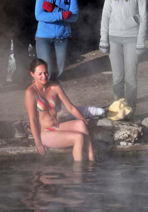 A tourist enters the water at a hot spring near the small village of Agua Brava.