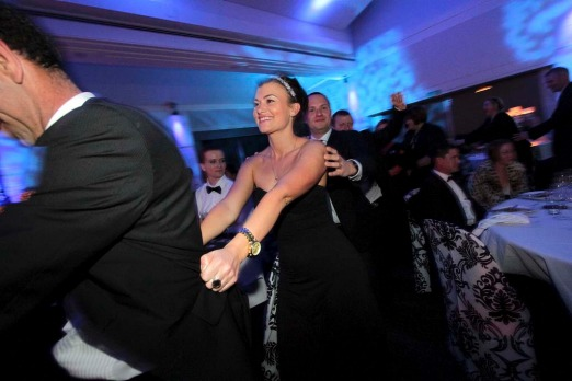 Guests do the Conga line at the Captain's Atlantic Dinner.