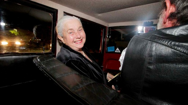 Noela Muirhead, from Mt Gravatt, gets a ride in one of Clive Palmer's vintage cars.