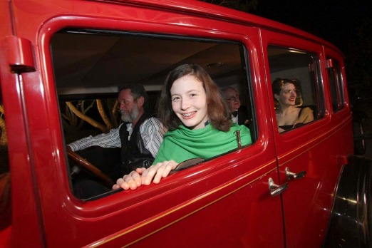 Mathilda Harley, 13, from Melbourne, gets a ride in one of Clive Palmer's vintage cars.