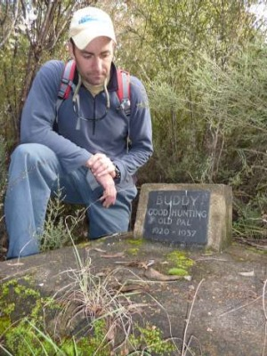 Dave Vincent pays his respects at Buddy's grave, still marked by a plaque.