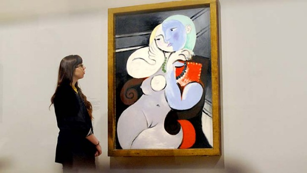 Pablo Picasso's 'Nude Woman in a Red Armchair' at the 'Picasso and Modern British Art' exhibition at the Tate gallery in ...