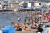 People bathe at the Pointe Rouge beach in Marseille, southern France.