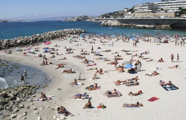 People bathe at the Prophet beach in Marseille, southern France.