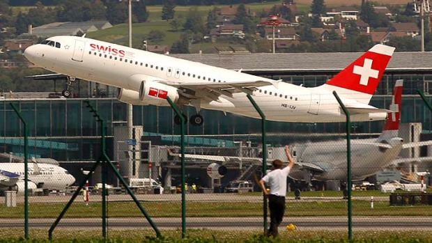 A Swiss airlines jet takes-off from Zurich airport.
