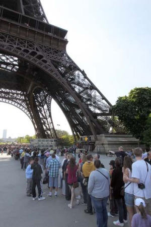 Queue horreur: Tourists line up to visit the Eiffel tower.