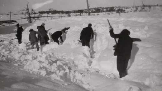 Possibly digging in the snow at the site of the lost train near Jincumbilly Siding in August 1949