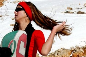 A girl holds her snowboard in the mountains of the ski resort of Faqra east of Beirut, Lebanon.