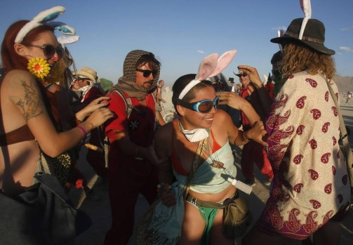 A woman wearing rabbit ears (C) tries to elude a member of Animal Control during the Billion Bunny March.
