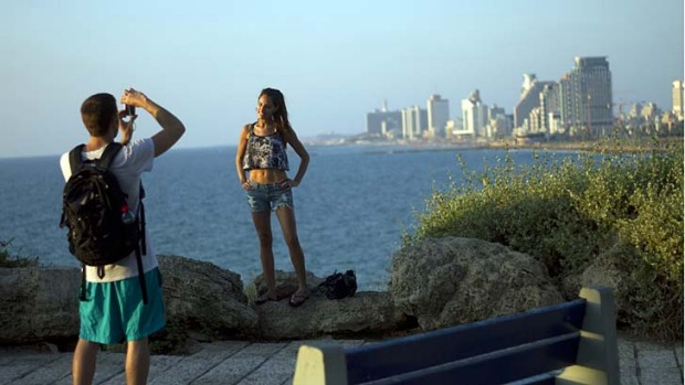 A tourist poses for a photo in Tel Aviv, Israel.