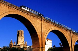 Fast trains cross the country, with Albi Cathedral in the background.