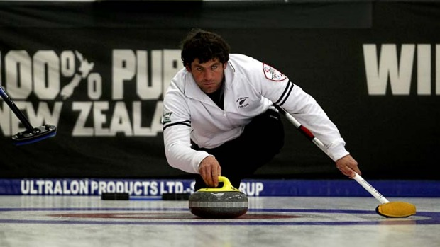 Swept up ... Sean Becker of New Zealand releases a stone during a curling match between New Zealand and Australia.