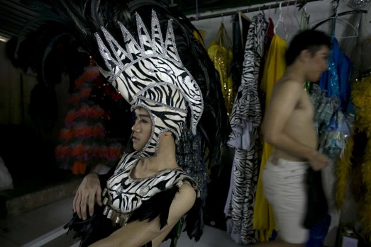 Ashi, a ladyboy dancer sits backstage after getting into costume before the Chiang Mai Cabaret show.
