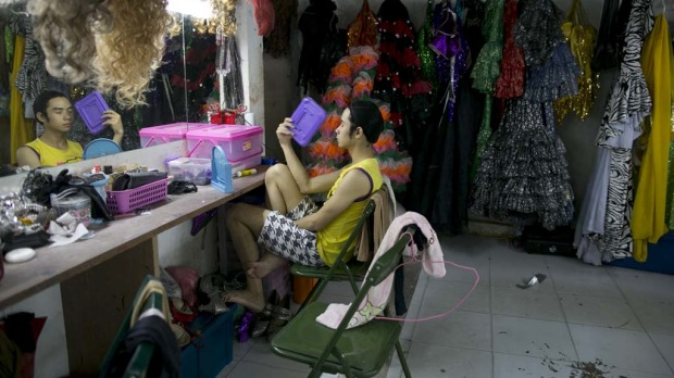 Ping, a ladyboy dancer fans himself in between acts backstage during the Chiang Mai Cabaret show.