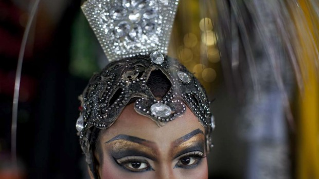 A ladyboy finishes her makeup just before a show at the Chiang Mai Cabaret show.