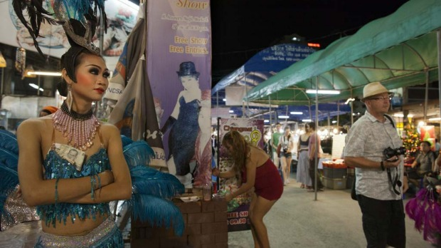 Dream, a ladyboy dancer at the Chiang Mai Cabaret show stands in the night market recruiting tourists before a performance.