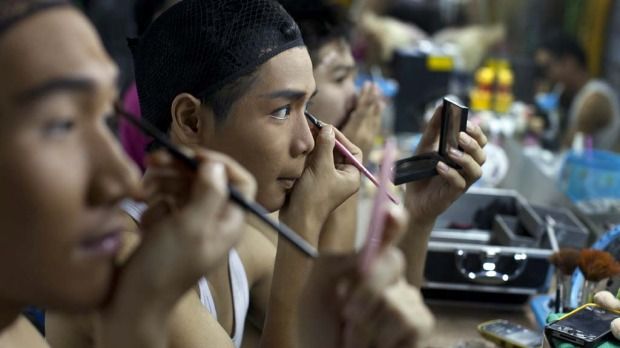 Ladyboy dancers, Putter(L) Nicky (centre) and Ashi (R) get made up before a performance.