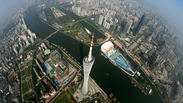 Modern metropolis ...  an aerial view of Canton Tower and the Pearl River.
