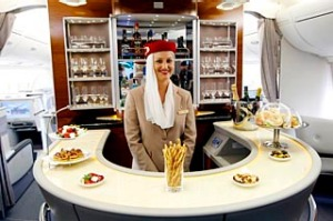 A flight attendant poses behind the bar in the rear of the business class section of Emirates' Airbus A380