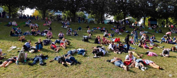 People rest on a meadow during the 179th Oktoberfest in Munich.
