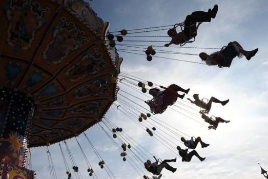 Visitors ride a chairoplane at the Theresienwiese Oktoberfest fair grounds in Munich.