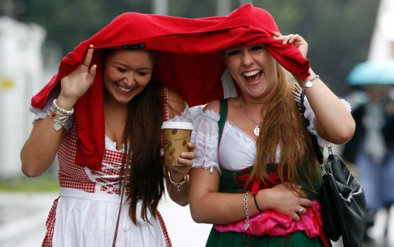 Two women arrive for the opening of Oktoberfest.