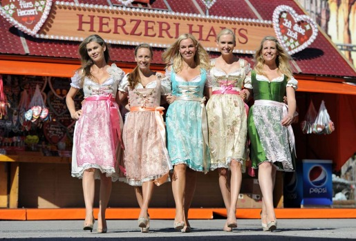 Models display Bavarian traditionnal outfit called Dirndl by designer Kathie Rezalou as they pose before the opening of the Oktoberfest.