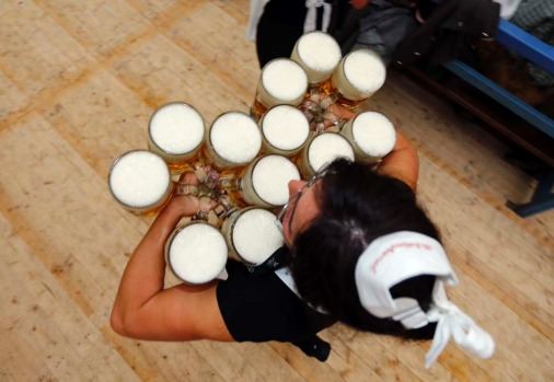 A waitress carries beer after the opening of the 179th Oktoberfest.