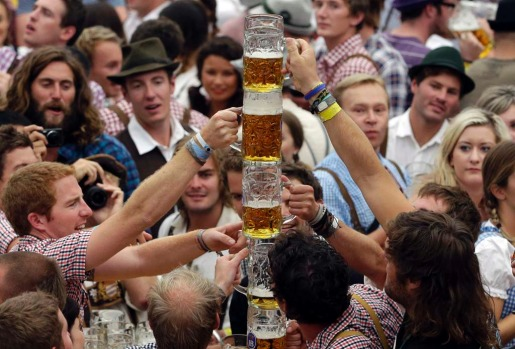"Young people celebrate the opening ceremony in the ""Hofbraeuzelt' beer tent."