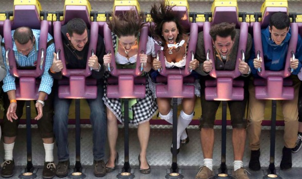 "Visitors enjoy the ride on the 'Top Spin"", a fairground ride, at the Oktoberfest."