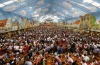 Revellers celebrate in a beer tent at the Munich Oktoberfest.