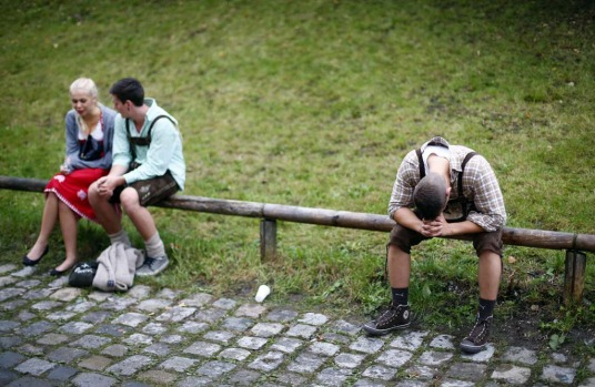 Revellers have a break from drinking at the Munich Oktoberfest.