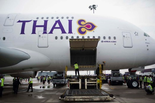 An employee checks inside the first Thai Airways Airbus A380-800 after arrival at Suvarnabhumi Airport in Bangkok.