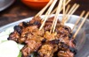 Satay. The ultimate Singaporean snack food: skewers of chicken, mutton, pork and beef grilled over charcoal and served ...