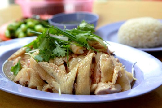 Hainanese chicken rice. A simple, subtle and stunning dish of poached chicken, chicken-flavoured steamed rice and ...