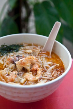 Laksa. This is the classic rich, spicy, coconutty soup filled with round rice noodles, fried tofu cubes, bean shoots, ...