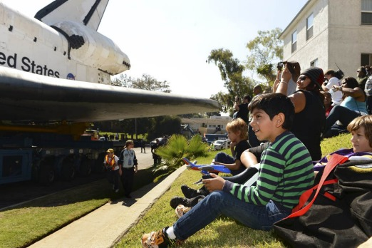 Spectators watch as Space Shuttle Endeavour travels to the California Science Center in Inglewood, Los Angeles.
