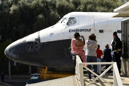 People watch as Space Shuttle Endeavour travels to the California Science Center on Manchester Blvd in Inglewood, Los ...