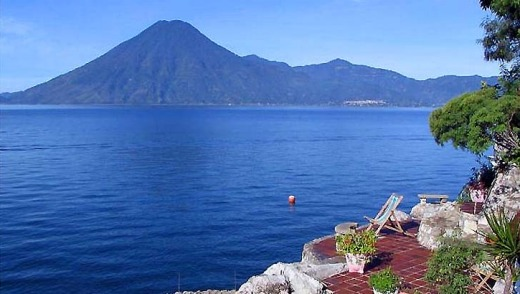 Casa del Mundo is a Spanish-colonial-style house set on the steep shores of Lake Atitlan, with views over the water to ...