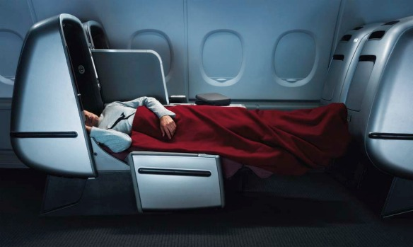 Room to stretch out ... business class on board a Qantas A380.