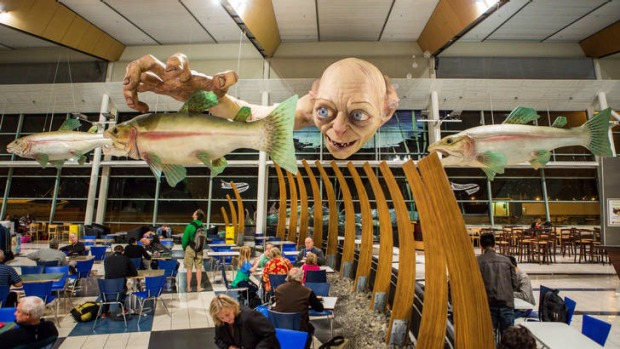 The 13-metre sculpture of  Gollum looms over passengers at Wellington Airport.