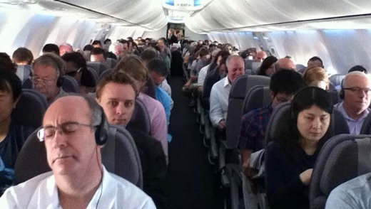Standing room only... The first Qantas Flight back to the Gold Coast was sold-out.