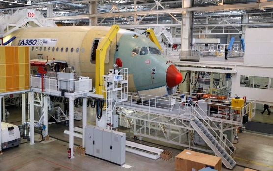 The nose section of the first Airbus A350 XWB plane is seen on the final assembly line in Toulouse, southwestern France.