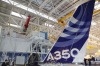 The vertical tail wing of the first Airbus A350 is seen on the final assembly line in Toulouse.