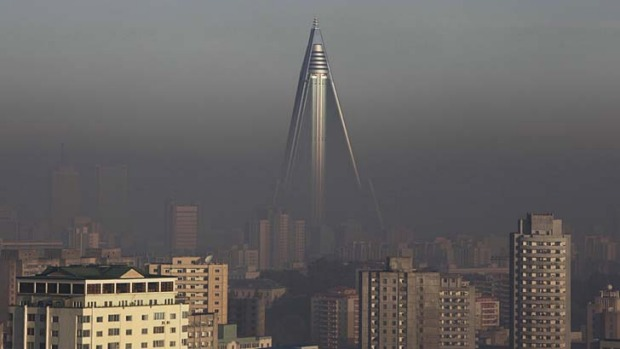 Decades to build ... the 105-storey Ryugyong hotel towers above other buildings in Pyongyang.